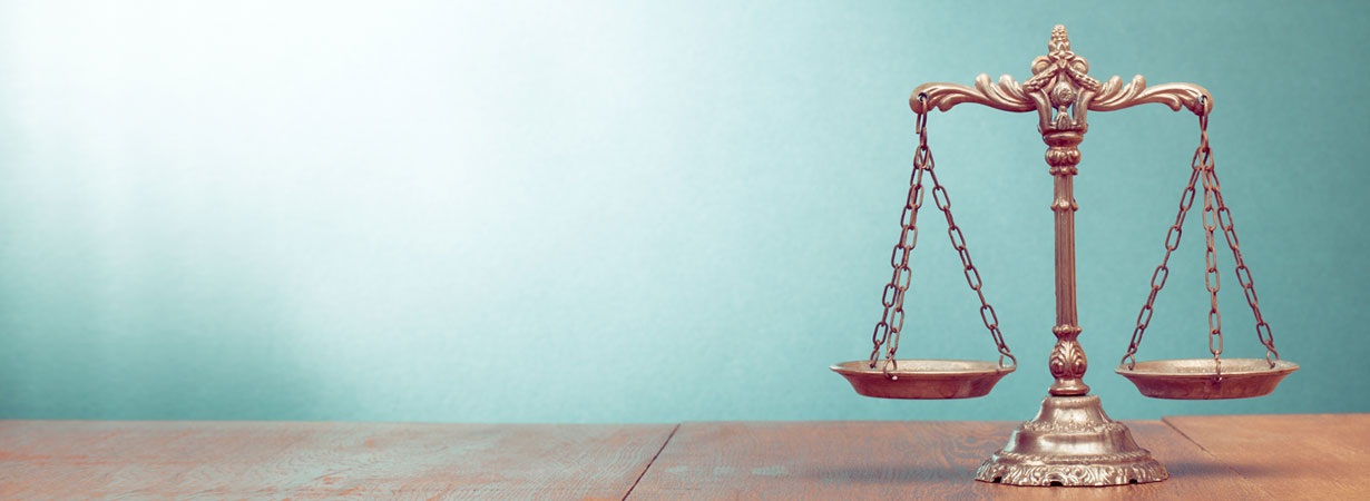 stock-photo-law-scales-on-table-symbol-of-justice-164503736_1230x450